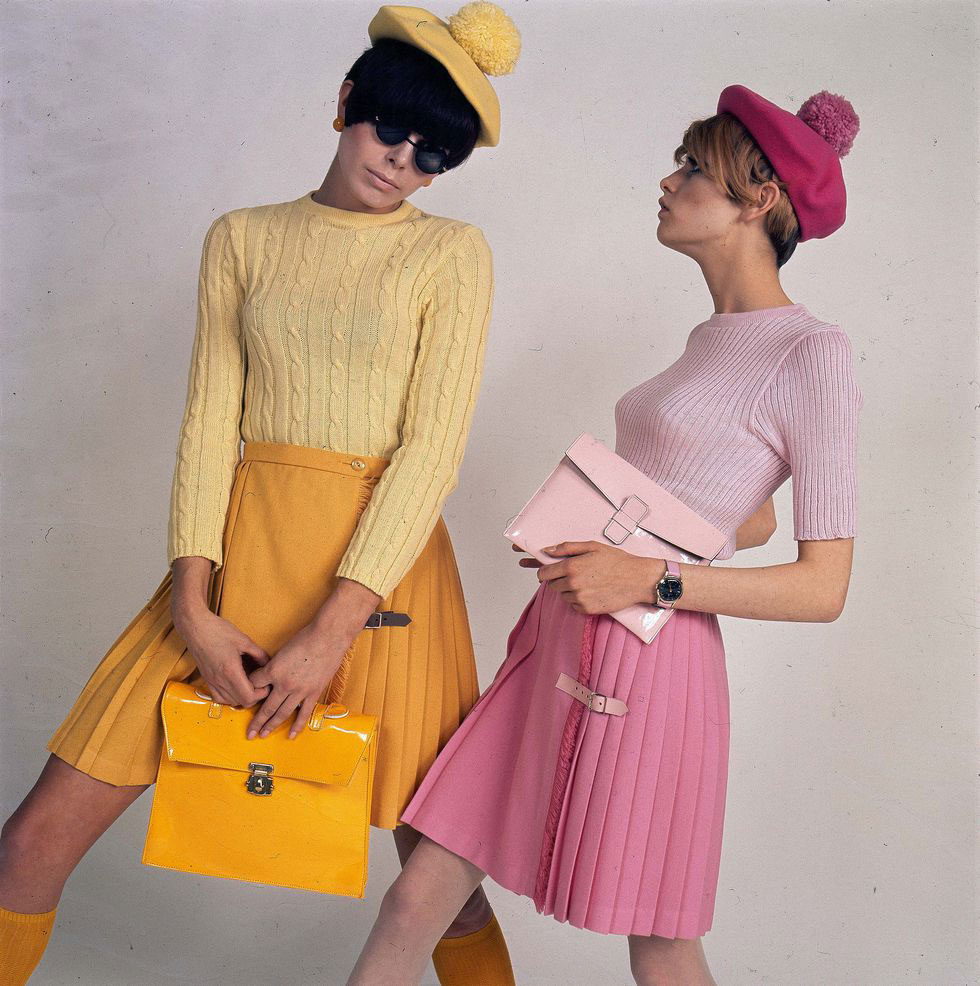 Twiggy Poses With Another Model In Coordinating Mary Quant Pleated Skirts, Sweaters And Berets