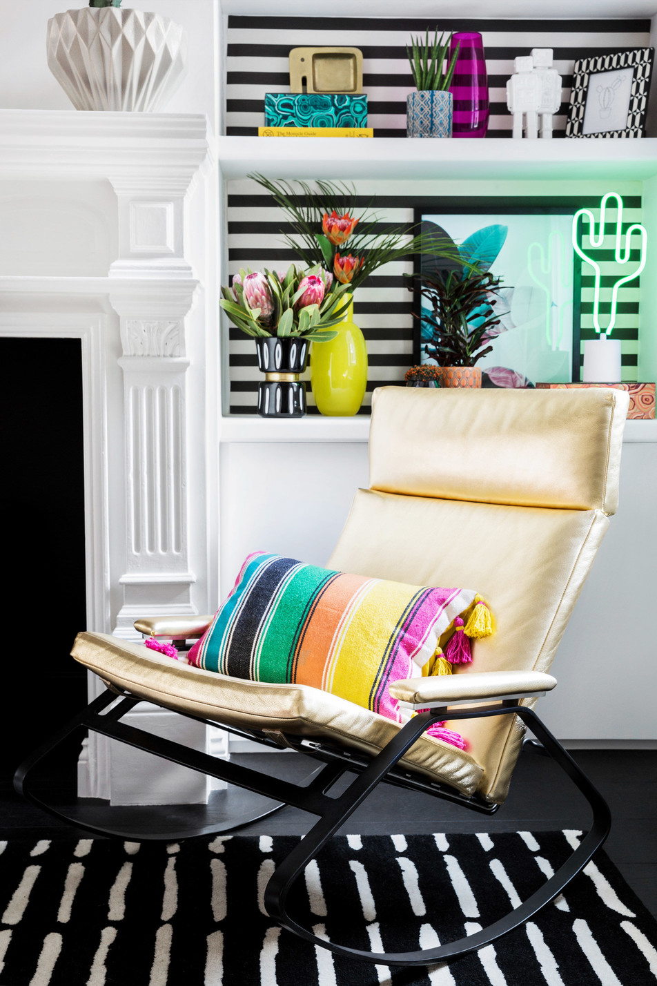 Modern Living Room Featuring Gold Rocking Chair