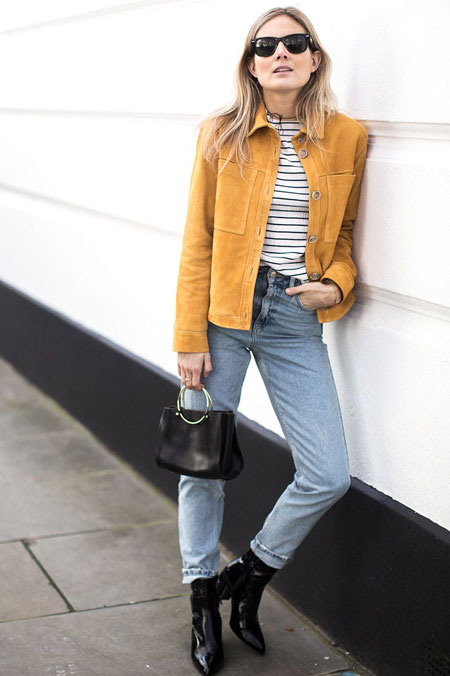 Model mixing Up Casual Faded Blue Jeans With A Yellow Jacket