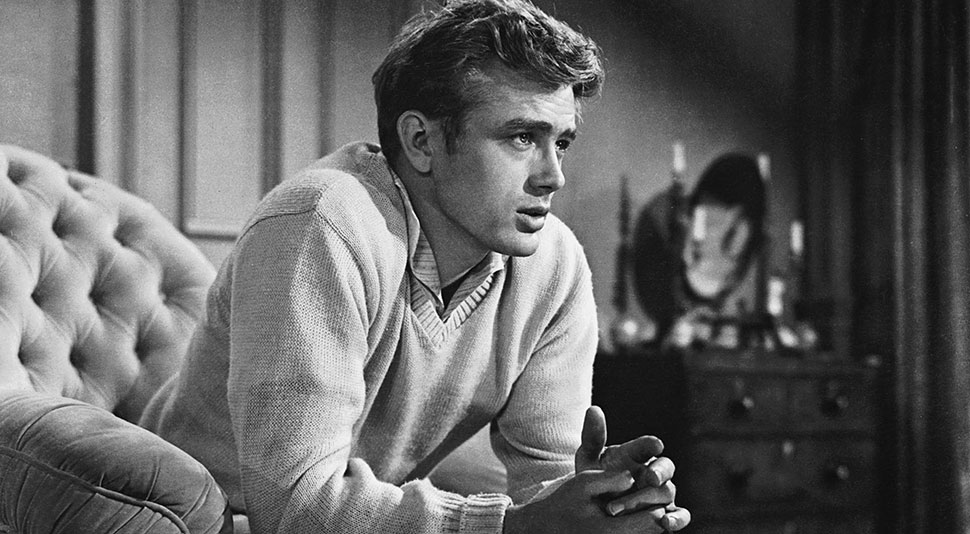 James Dean wearing a  white coloured v-neck jumper